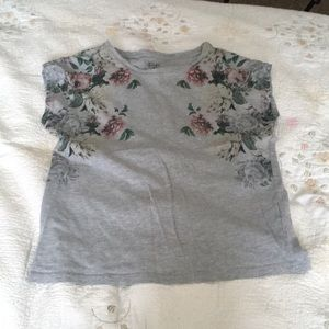 A T-shirt with flowers going down the sides